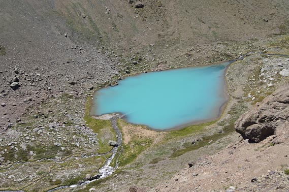 The turquoise-blue color of Station Lake, a small lake perched above the northwest shore of Laguna Negra, is an indication that it is rich in sediment, and possibly biological nutrients, making it a target of scientific interest. Credit: Nathalie Cabrol