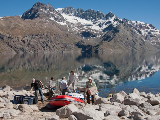 PLL team members unload supplies and scientific instruments from motorized Mariner One (the red boat) and its motorless companion, Bath Toy. Credit: Henry Bortman