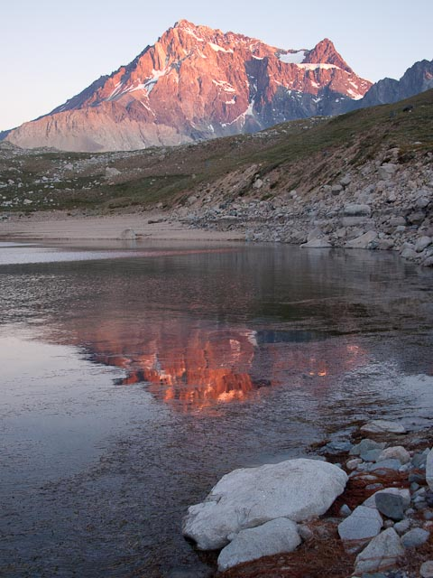 At sunset, the normally gray Meson Alto, the mountain that dominates the view to the east of Laguna Negra, glows with color. Credit: Henry Bortman