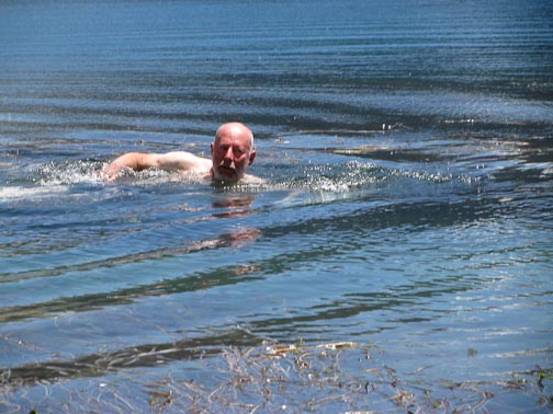 Blog author Henry Bortman attempts to practice his freestyle, but the chilly waters of Laguna Negra, which make relaxation near impossible, encourage bad form. Credit: Claudia Perez