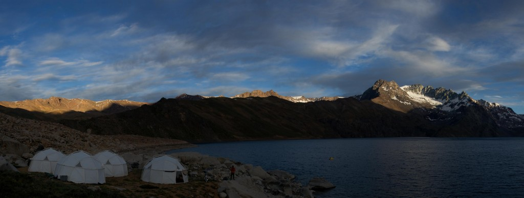 The domes of PLL Base Camp, still in shadow, while across the lake Cerro Echaurren catches early morning light. Credit: Henry Bortman