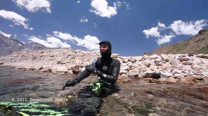PLL Principal Investigator Nathalie Cabrol prepares to investigate the shallow waters along the southeast shore of Laguna Negra. Credit: XenoQuest Media
