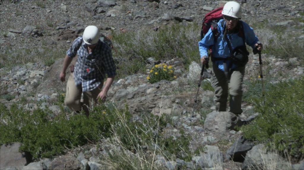Nathalie Cabrol (r ) and Chris Haberle, during an earlier visit, make their way up the steep slopes above the northwest shore of Laguna Negra. Credit: XenoQuest Media